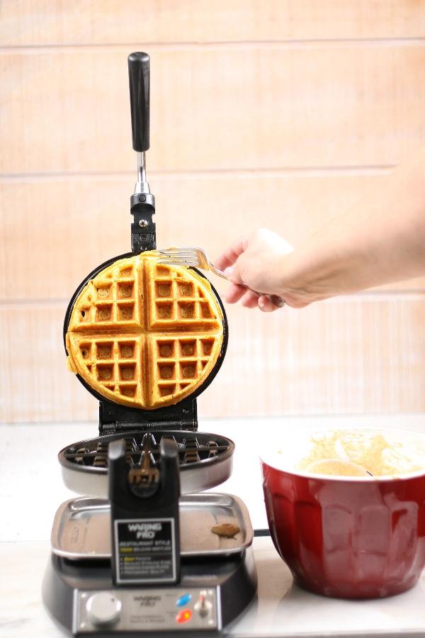 pulling waffle out of Belgian waffle iron