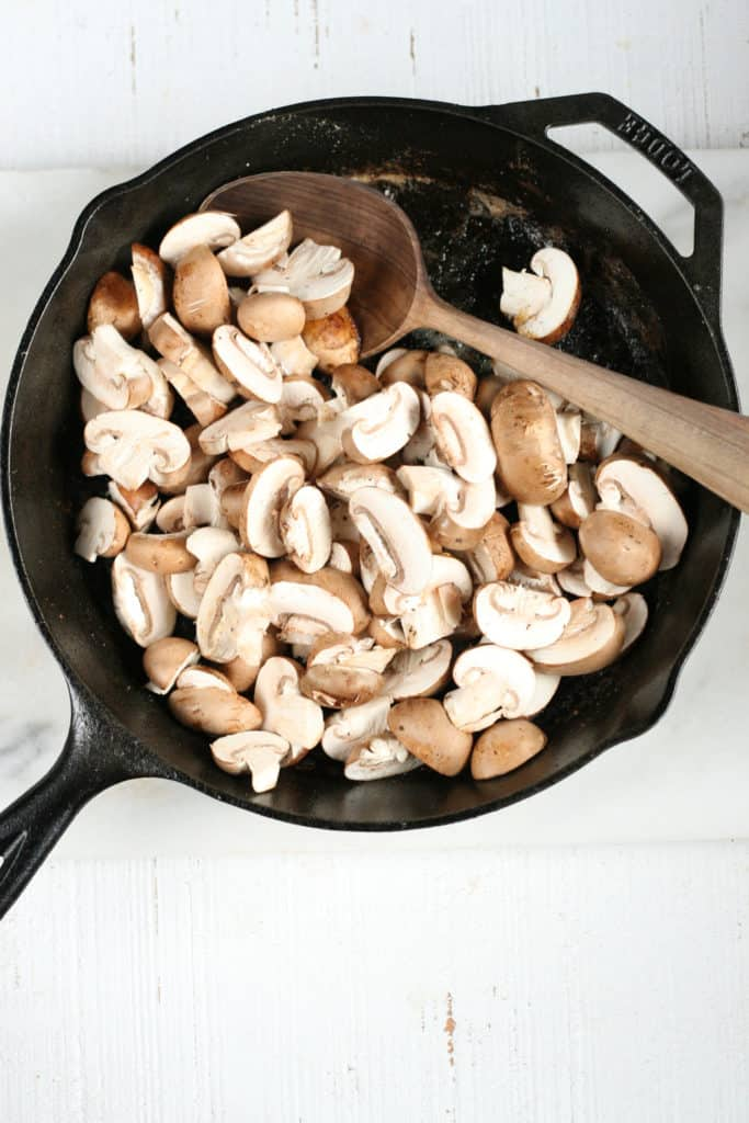 mushrooms in a cast iron skillet cooking