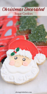 homemade Christmas decorated sugar cookies Santa face
