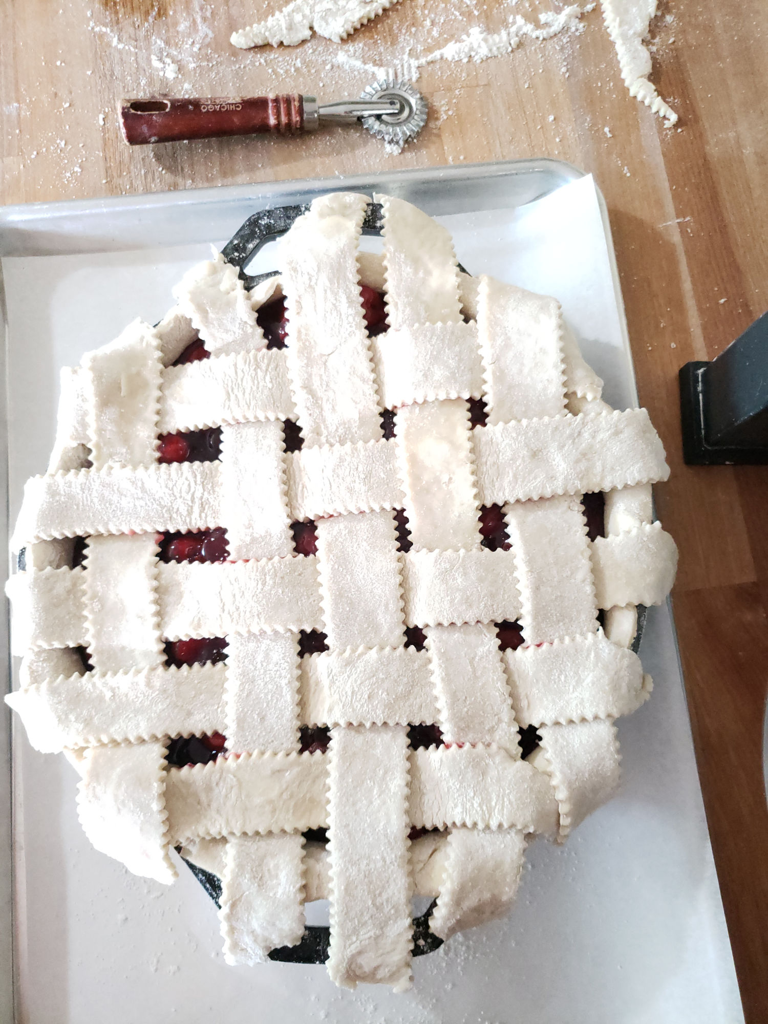 cherry pie with a lattice crust before baking in a 2-handle cast iron skillet.