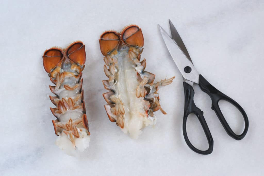 cooked lobster tails with kitchen shears