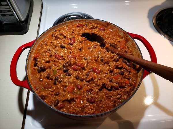 chili in a red Dutch oven