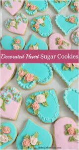 Heart shaped sugar cookies with royal icing roses