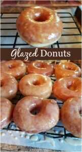 glazed donuts drying on a baking rack