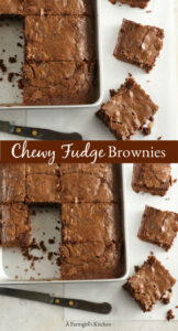 fudge brownies cut into squares on a piece of white marble