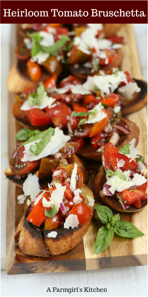 Heirloom tomato bruschetta on toasted baguettes with fresh basil