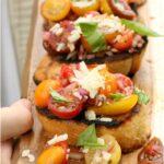 tomato bruschetta on wooden serving tray