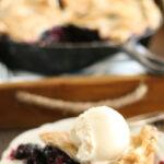 slice of blueberry pie with scoop of vanilla ice cream