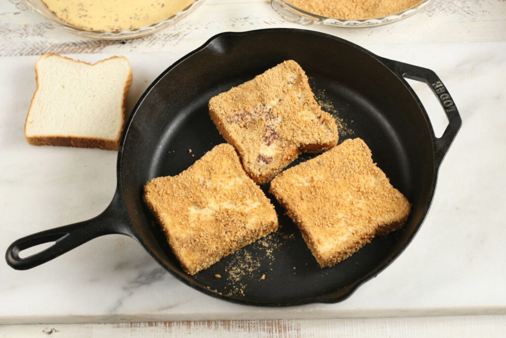 S'more French Toast cooking in a cast iron skillet