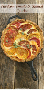 quiche in a cast iron skillet on reclaimed wood boards
