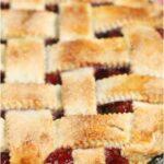 cherry pie with lattice crust in dual handle cast iron skillet
