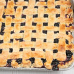 Blueberry pie on a half sheet pan with lattice crust