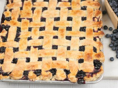 Blueberry pie on a half sheet pan with lattice crust
