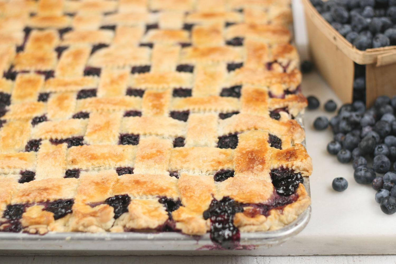 Blueberry pie with lattice crust on half sheet pan.