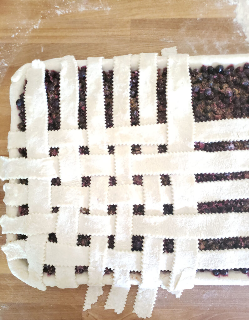 pie on sheet pan weaving lattice crust