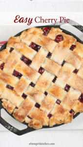 cherry pie with lattice crust in cast iron skillet