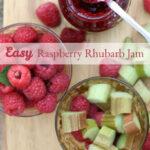 raspberry jam in glass jar with spoon