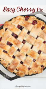 cherry pie with a lattice crust in a cast iron skillet