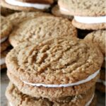 oatmeal cream pies stacked on each other on butcher block