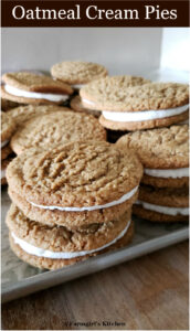 oatmeal cream pies stacked on top of each other on a half sheet pan