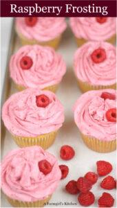 Raspberry frosting on lemon cupcakes on half sheet pan