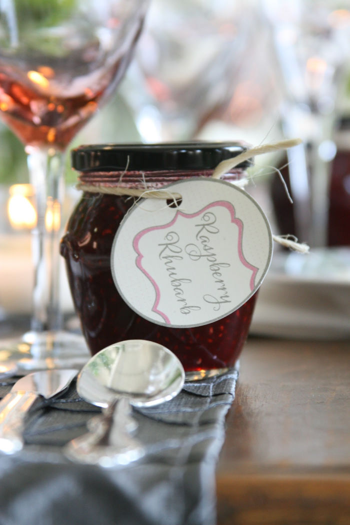 glass jar of homemade jam with tag tied on with natural twine.