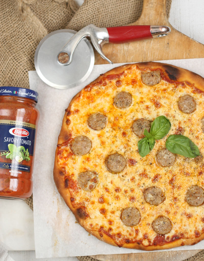homemade Italian style pizza with pieces of sweet sausage