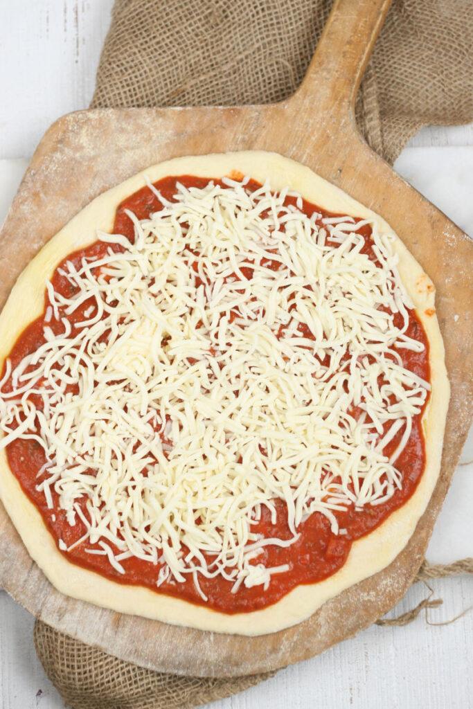 homemade Italian style pizza dough with shredded mozzarella