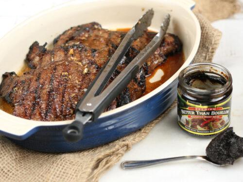 grilled steak in a ceramic dish