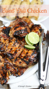 grilled chicken on serving plate lime slices and metal tongs