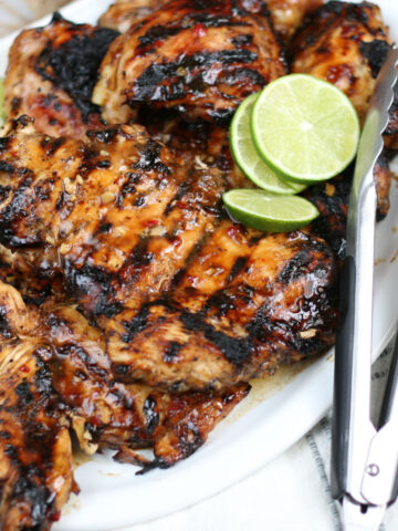 grilled chicken on a white serving plate
