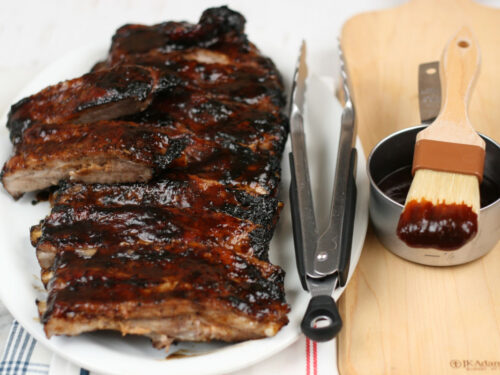 BBQ pork ribs on a white serving plate