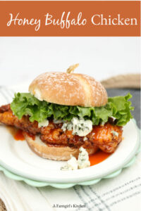 Honey Buffalo chicken sandwich on roll and topped with chunks of blue cheese
