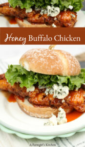 buffalo chicken sandwich on round roll with chunks of blue cheese and green leaf lettuce