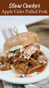 BBQ pork sandwich on a roll, topped with homemade coleslaw