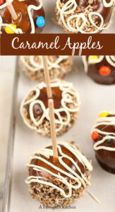 caramel and chocolate dipped apples with wooden stick in center