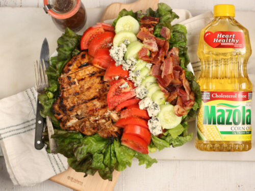 Garden salad with grilled chicken, tomatoes, blue cheese, cucumbers, and bacon