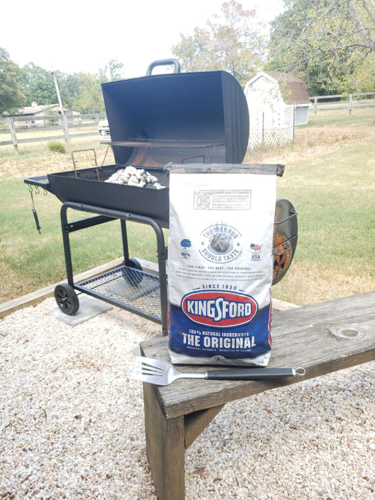 bag of Kingsford Charcoal near outdoor grill on patio