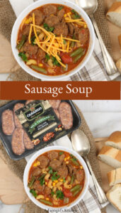 Sausage soup in bowl topped with cheddar cheese
