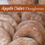 cinnamon sugar covered apple cider doughnuts leaning up against each other on sheet pan