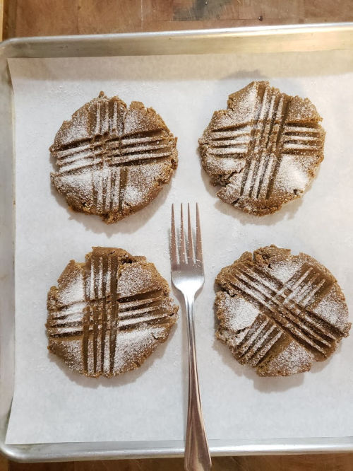 Making fork marks in Molasses cookies on half sheet pan