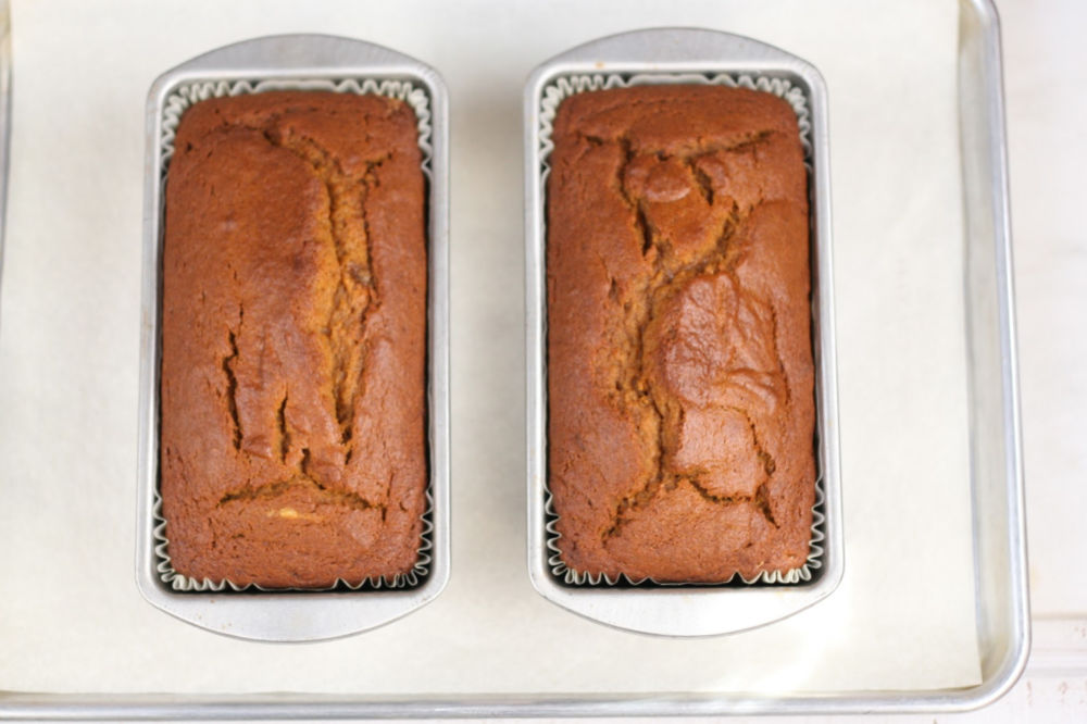pumpkin bread in metal loaf pans cooling on half sheet pan