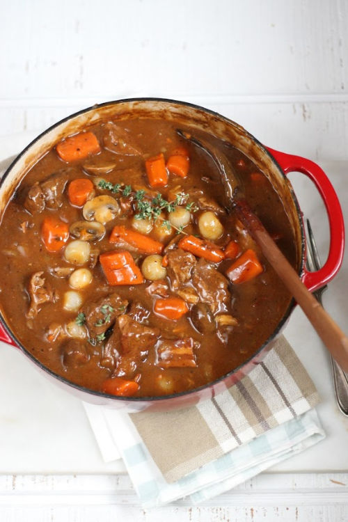 Red Dutch oven with Boeuf Bourguignon