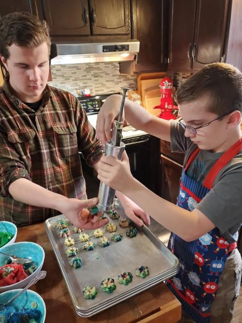 Kids making Spritz cookies in the kitchen