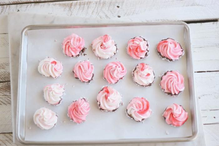 peppermint swirled meringues on sheet pan
