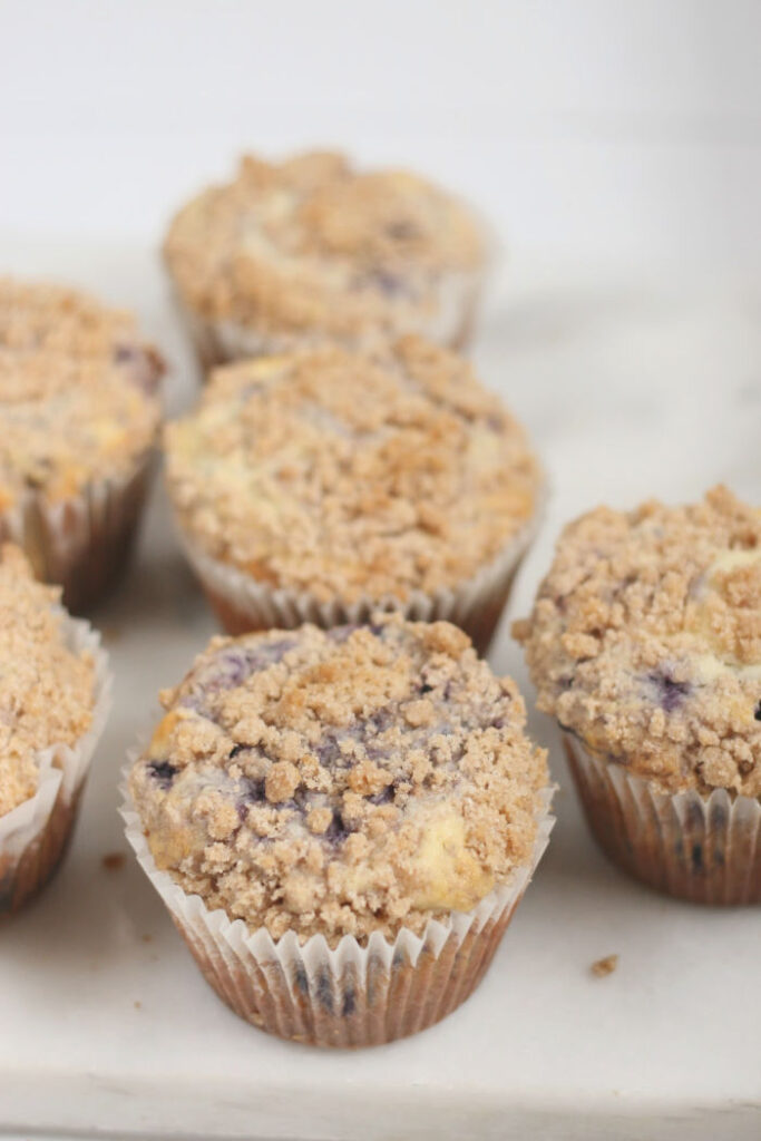 blueberry muffins on white marble