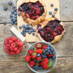 berry galettes on reclaimed wood with mixed berries