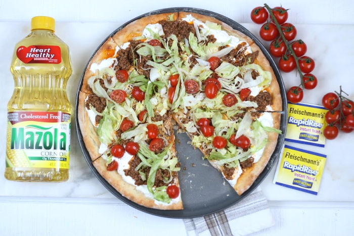 pizza with taco toppings cut into slices
