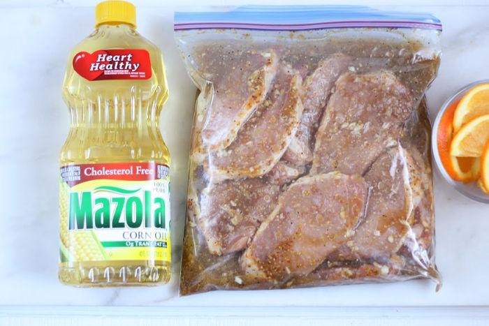 pork chops in ziploc bag with marinade