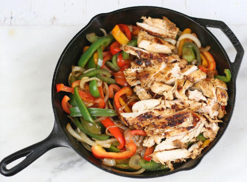 cast iron skillet with chicken fajitas